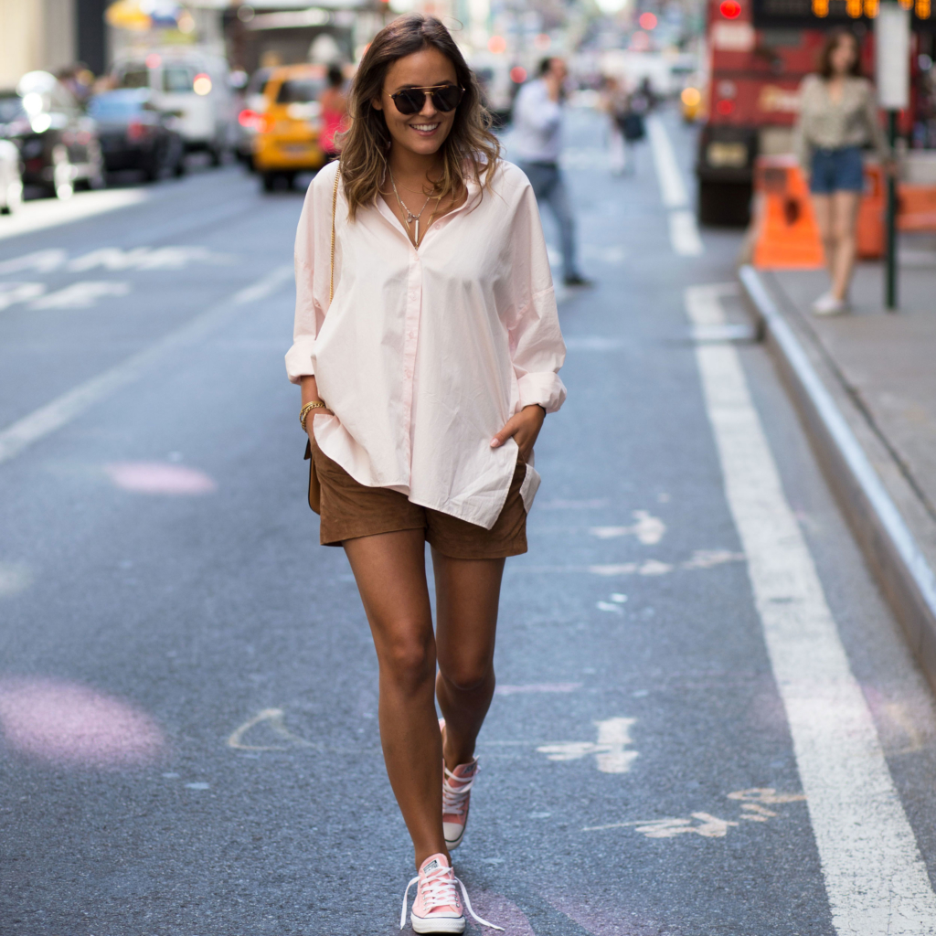 a pink oversized blouse with a cognac colored leather shorts, my pink Converse chucks and  Kapten&Son sunglasses.